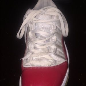 Red and white Jordan 11's low